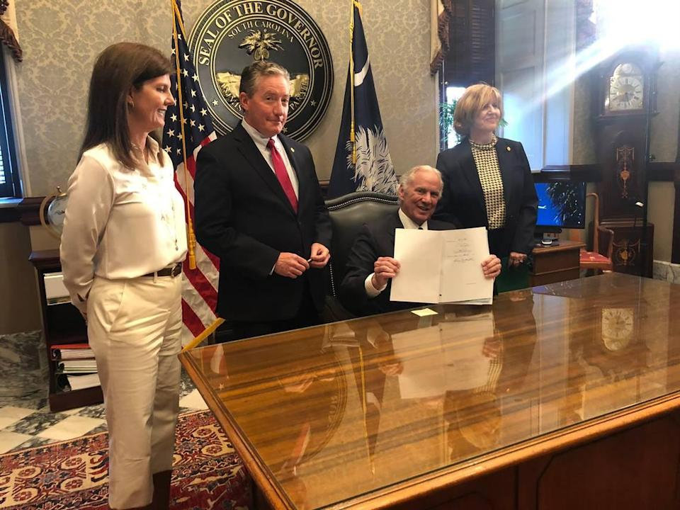 S.C. Gov. Henry McMaster signed a bill on Thursday, April 22, 2021, that requires every school district to give students the option to return to school in person, five days a week. Also pictured from left is S.C. Lt. Gov. Pamela Evette, Senate Education Committee Chairman Greg Hembree, R-Horry, and schools Superintendent Molly Spearman.
