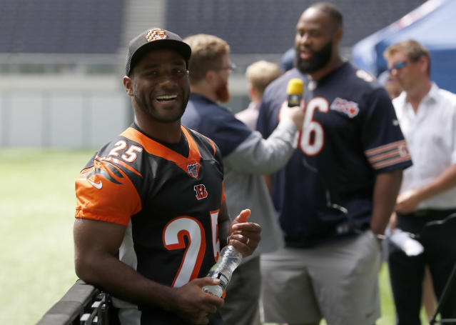 NFL Player Giovani Bernard of the Cincinnati Bengals pauses before an interview during the final tournament for the UK's NFL Flag Championship, featuring qualifying teams from around the country, at the Tottenham Hotspur Stadium in London, Wednesday, July 3, 2019. The new stadium will host its first two NFL London Games later this year when the Chicago Bears face the Oakland Raiders and the Carolina Panthers take on the Tampa Bay Buccaneers. (AP Photo/Frank Augstein)