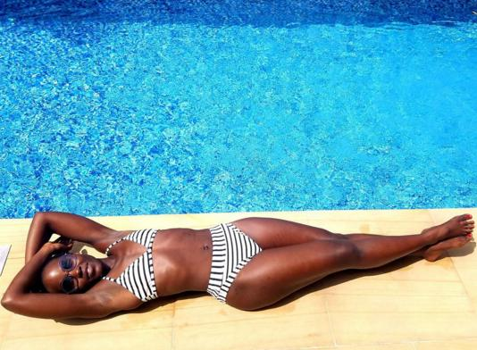She also showed her stripes — and bikini bod — while lounging poolside in a striped two-piece suit. While she captioned it