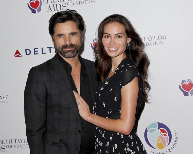 John Stamos and Caitlin McHugh make their first red carpet appearance since getting engaged. (Photo: Getty Images)