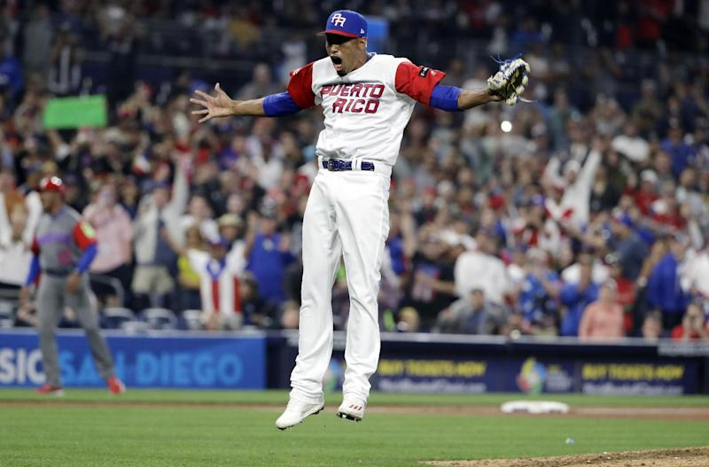 Puerto Rico pitcher Edwin Diaz reacts after getting the last out to defeat the Dominican Republic in a second-round World Baseball Classic game Tuesday, March 14, 2017, in San Diego. Puerto Rico won, 3-1. (AP Photo/Gregory Bull)