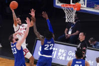 St. John's guard Julian Champagnie (2) goes to the basket against Seton Hall forward Sandro Mamukelashvili (23) and guard Myles Cale (22) during the first half of an NCAA college basketball game in the quarterfinals of the Big East conference tournament, Thursday, March 11, 2021, in New York. (AP Photo/Mary Altaffer)