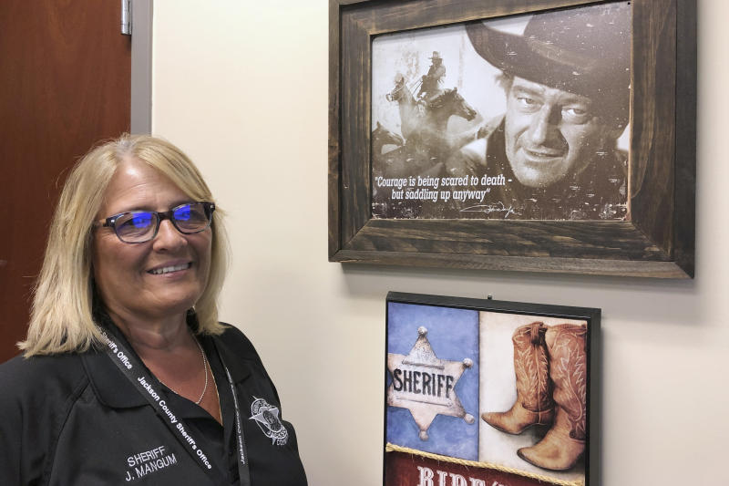 In this Sept. 12, 2019 photo, Jackson County Sheriff Janis Mangum is shown at her office, in Jefferson, Ga. A ransomware attack in March took down the office's computer system, forcing deputies to handwrite incident reports and arrest bookings. (AP Photo/Sudhin Thanawala)
