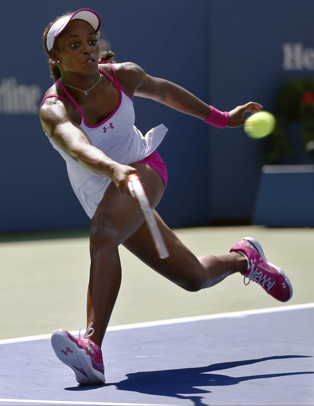 Sloane Stephens, of the United States, returns a shot against Johanna Larsson, of Sweden, during the second round of the 2014 U.S. Open tennis tournament, Wednesday, Aug. 27, 2014, in New York. (AP Photo/Matt Rourke)