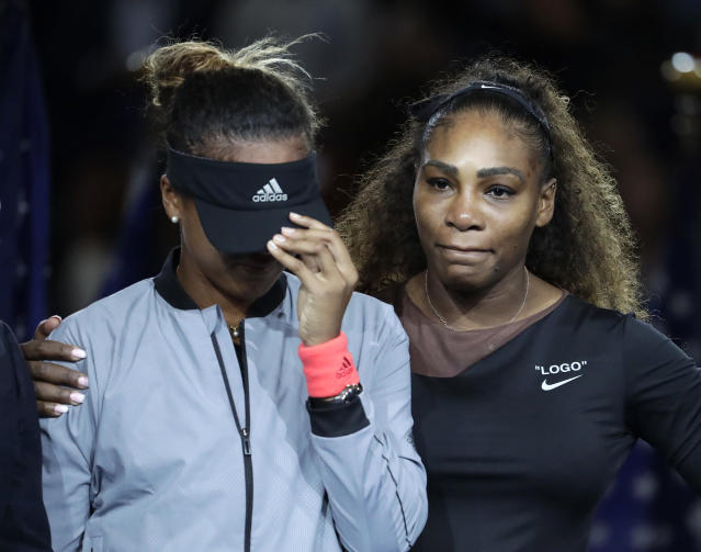 FILE - In this Sept. 8, 2018, file photo, Naomi Osaka, left, of Japan, is hugged by Serena Williams after Osaka defeated Williams in the women's final of the U.S. Open tennis tournament in New York. The tenor of the final between Williams and champion Osaka, whose terrific performance was largely ignored amid the chaos that enveloped Arthur Ashe Stadium, began to shift after chair umpire Carlos Ramos warned Williams for receiving coaching signals. (AP Photo/Julio Cortez, File)
