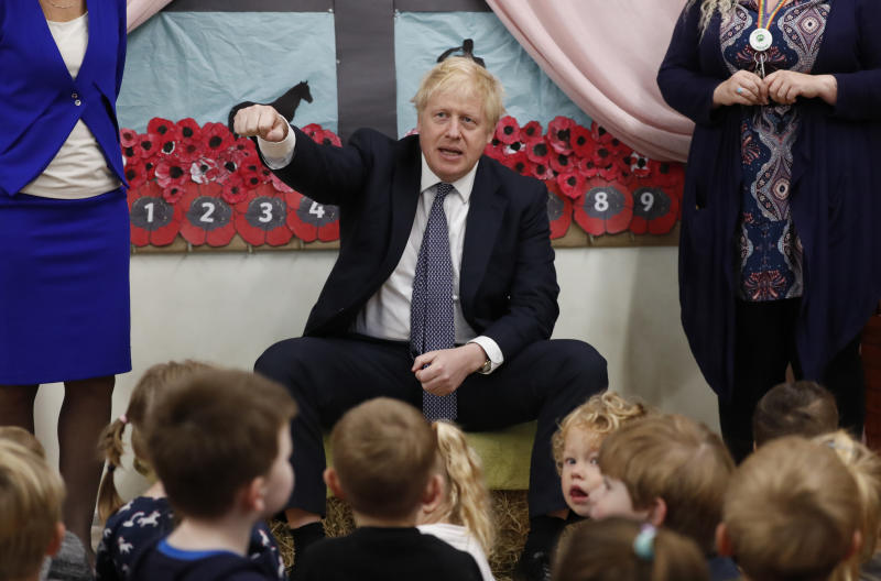 Britain's Prime Minister Boris Johnson visits the West Monkton CEVC Primary School on a General Election campaign trail in Taunton, England, Thursday, Nov. 14, 2019. Britain goes to the polls on Dec. 12. (AP Photo/Frank Augstein, Pool)