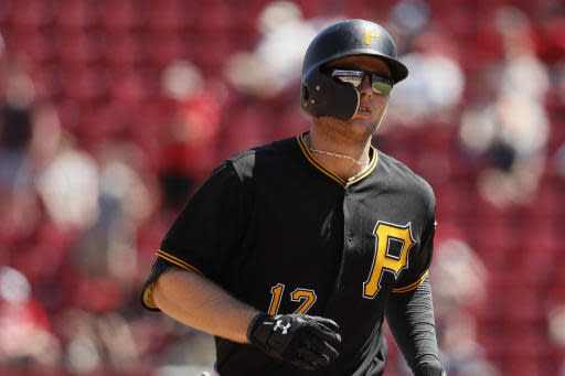 Pittsburgh Pirates' Austin Meadows runs the bases after hitting a two-run home run off Cincinnati Reds relief pitcher Amir Garrett in the ninth inning of a baseball game, Thursday, May 24, 2018, in Cincinnati. (AP Photo/John Minchillo)