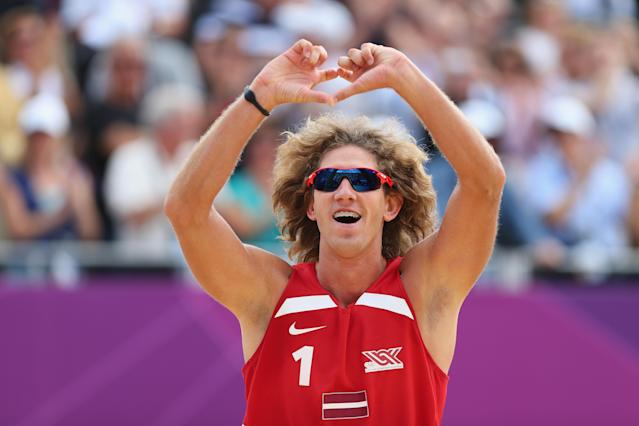 LONDON, ENGLAND - JULY 28: Aleksandrs Samoilovs of Latvia celebrates during the Men's Beach Volleyball match between Poland and Latvia on Day 1 of the London 2012 Olympic Games at the Horse Guards Parade on July 28, 2012 in London, England. (Photo by Ryan Pierse/Getty Images)