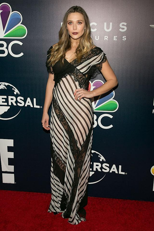 <p>The actress wore a striped Alberta Ferretti gown that featured lace detailing to NBCUniversal's 74th Annual Golden Globes After Party. She styled her hair in loose waves and wore a bold lip color. (Photo: Getty Images) </p>