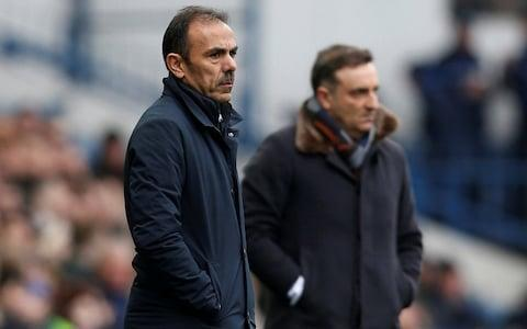 """There was no revenge for Carlos Carvalhal, just a collective shrug of indifference from his former club Sheffield Wednesday, a stalemate and a FA Cup replay that his new team, Swansea City, would have preferred to avoid. In fact, for all the supposed excitement generated by his return, less than two months after he was sacked by the Championship club, this was an underwhelming cup tie between two sides who huffed and puffed but rarely looked like blowing any doors down. Carvalhal was warmly applauded off the Swansea coach by the Wednesday supporters who had bothered to congregate outside the players' entrance to greet him, and that was it. There was no emotion, no suggestion of animosity, just ambivalence. It was the equivalent of an ex walking into a bar with a glamorous new partner and barely bothering to look in their former lover's direction. It was a very Yorkshire reaction. Carvalhal may have moved on to better things since Wednesday sacked him on Christmas Eve, re-emerging three days later as a replacement for Paul Clement at Swansea, but nobody in Sheffield seems to much care. Jos Luhukay replaced Carlos Carlvalhal at Sheffield Wednesday Credit: REUTERS He led them to two play-offs, losing in the final to Hull in 2016 and the semi-finals to Huddersfield last year, but there was little opposition to his sacking and nothing to suggest anyone feels it was a mistake now, despite the fine job he has done in South Wales since. His former employers have remained stuck in the rut he left them in, the anticipated uplift under his replacement, the Dutchman Jos Luhukay, yielding an FA Cup run, but just one league win. Whatever the problems were, Luhukay has not solved any of them quickly. This looked like the perfect time for Carvalhal to make a point, but having rested key players because of the ongoing relegation battle, Swansea were unable to dispose of spirited opponents. """"We didn't want a replay,"""" said Carvalhal, who revealed Alfie Mawson locked his knee warming u"""