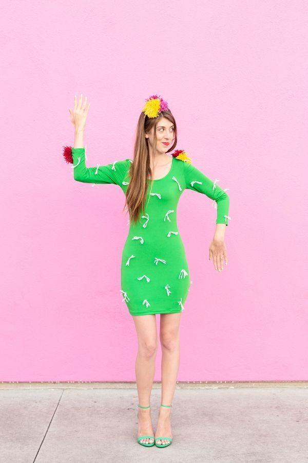 """<p>This easy-t0-make costume isn't nearly as prickly as the real thing, but you'll still look sharp. </p><p><a class=""""link rapid-noclick-resp"""" href=""""https://www.amazon.com/dp/B014K7933I/ref=twister_B014OUXQI4?tag=syn-yahoo-20&ascsubtag=%5Bartid%7C10055.g.2750%5Bsrc%7Cyahoo-us"""" rel=""""nofollow noopener"""" target=""""_blank"""" data-ylk=""""slk:SHOP GREEN DRESSES"""">SHOP GREEN DRESSES</a></p><p><em><a href=""""https://studiodiy.com/2015/09/28/diy-cactus-costume/"""" rel=""""nofollow noopener"""" target=""""_blank"""" data-ylk=""""slk:Get the tutorial at Studio DIY »"""" class=""""link rapid-noclick-resp"""">Get the tutorial at Studio DIY » </a></em></p>"""