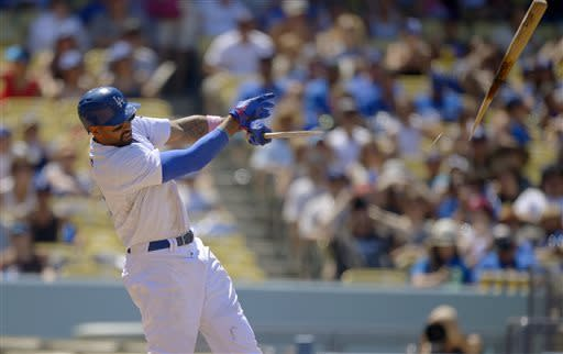 Los Angeles Dodgers' Matt Kemp breaks his bat as he hits his 1,000th career hit during the fifth inning of the National League MLB baseball game against the Miami Marlins Sunday, May 12, 2013, in Los Angeles. (AP Photo/Mark J. Terrill)