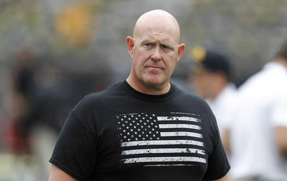 """FILE - In this Sept. 1, 2018, file photo, Iowa strength and conditioning coach Chris Doyle walks on the field before an NCAA college football game between Iowa and Northern Illinois in Iowa City, Iowa. Jacksonville Jaguars coach Urban Meyer defended the hiring of former Iowa assistant Chris Doyle on Thursday, Feb. 11, 20201, by saying he """"vetted him thoroughly along with our general manager and owner."""" Iowa agreed to pay Doyle $1.1 million in a resignation agreement last June after scores of former players said he bullied and discriminated against them. (AP Photo/Charlie Neibergall, File)"""
