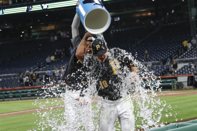 Pittsburgh Pirates' Bryan Reynolds (10) gets a bucket of ice water dumped over him by Chris Archer in celebration after Reynolds drove in two runs with a single in the ninth inning of a baseball game to defeat the Miami Marlins, Wednesday, Sept. 4, 2019, in Pittsburgh. The Pirates won 6-5. (AP Photo/Keith Srakocic)
