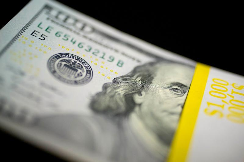 A U.S. $100 bill sits on a stack of currency in this arranged photograph in Washington, D.C., U.S., on Thursday, Feb. 6, 2014. A suspension of the federal debt limit, enacted by Congress in October, is scheduled to expire Feb. 7. Treasury Secretary Jacob J. Lew has urged lawmakers to act quickly to raise the cap, saying the governments ability to meet its obligations will run out before the end of this month. Photographer: Andrew Harrer/Bloomberg via Getty Images