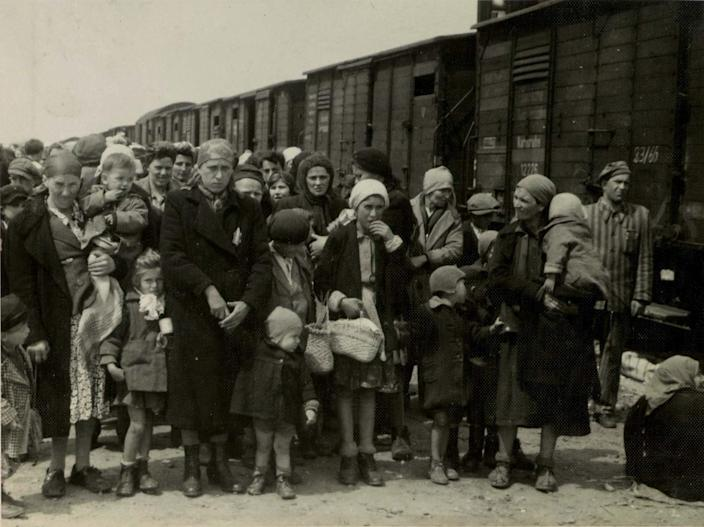 "In this May 1944 photo provided by Yad Vashem Photo Archives, Jewish women and children deported from Hungary, separated from the men, line up for selection on the selection platform at Auschwitz camp in Birkenau, Poland. Johann ""Hans"" Breyer, 87, of Philadelphia admits he was a guard at Auschwitz, but says he was never in Auschwitz-Birkenau, the part of the death camp used as a killing machine for Jews. World-War II-era documents obtained by The Associated Press indicate otherwise. Those files are now in the hands of German authorities, and could provide the legal basis for charging Breyer as an accessory to the murder of hundreds of thousands of Jews in the Nazi death camp. (AP Photo/Yad Vashem Photo Archives)"