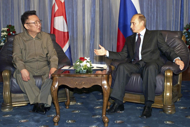 FILE - In this Aug. 23, 2002 file photo, Russian President Vladimir Putin, right, gestures as he talks to North Korean then leader Kim Jong Il during their meeting in Vladivostok. North Korean leader Kim Jong Un's meeting with Russian President Vladimir Putin gives an intriguing twist to the global diplomatic push to resolve the nuclear standoff with North Korea, which appeared to hit a wall after a summit between Kim and President Donald Trump collapsed in February. (AP Photo/Alexander Zemlianichenko, File)