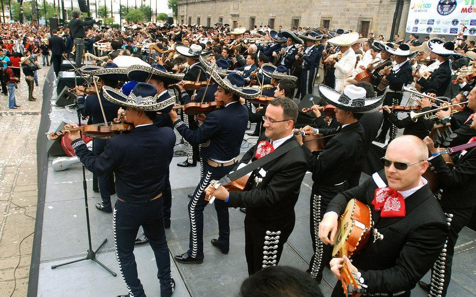August, dates TBD In Mexico, mariachi is more than just music—it's a symbol of national pride and culture. To celebrate the iconic music, each fall, mariachi lovers from around the globe head to Guadalajara, Mexico for a ten-day celebration of all things mariachi. Not only is the festival the site of the world's largest mariachi competition, but there are also concerts, galas, rodeos, art exhibits, crafts, and even Catholic masses featuring mariachi music. It's all topped off with a grand parade when Guadalajara's streets are filled with mariachi on horseback, strolling musicians, women in traditional dress, and floats topped with charros (Mexican cowboys). In between concerts, visitors can hop on a train for tastings of the region's other famous export—tequila.