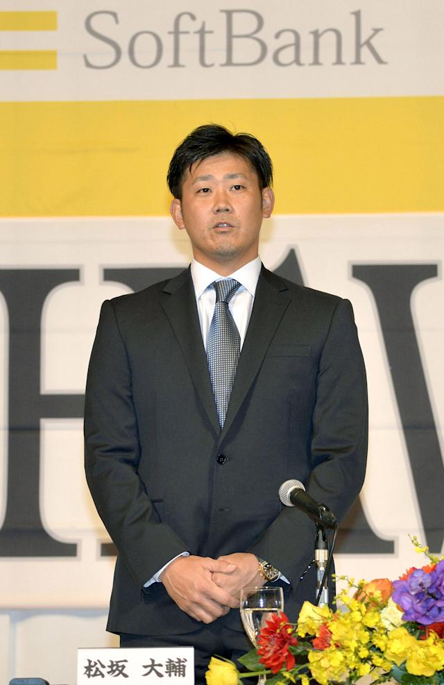 Daisuke Matsuzaka attends a press conference at a hotel in Fukuoka, western Japan Friday, Dec. 5, 2014. Matsuzaka has signed a contract with the Softbank Hawks of Japan's Pacific League after eight years in Major League Baseball. (AP Photo/Kyodo News)