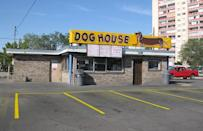 """<p>Fans of """"Breaking Bad"""" and """"Better Call Saul"""" will already be familiar with the Dog House, which was <a href=""""https://www.theactivetimes.com/travel/51-famous-movie-locations-you-can-actually-visit?referrer=yahoo&category=beauty_food&include_utm=1&utm_medium=referral&utm_source=yahoo&utm_campaign=feed"""" rel=""""nofollow noopener"""" target=""""_blank"""" data-ylk=""""slk:featured in multiple scenes on the pair of AMC shows"""" class=""""link rapid-noclick-resp"""">featured in multiple scenes on the pair of AMC shows</a>. And while you won't find the fictional Jesse Pinkman there, you will find foot-long hot dogs and other classic drive-in fare like Frito pie, burgers and shakes. Be sure to top your hot dog or burger with the signature chili; it's a little on the spicy side, but it's well worth it.</p>"""