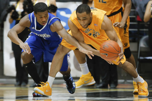 Wichita State's Tekele Cotton steals the ball from Drake's Richard Carter during the first half of an NCAA college basketball game Saturday, Feb. 22, 2014, at Koch Arena in Wichita, Kan. (AP Photo/The Wichita Eagle, Travis Heying)