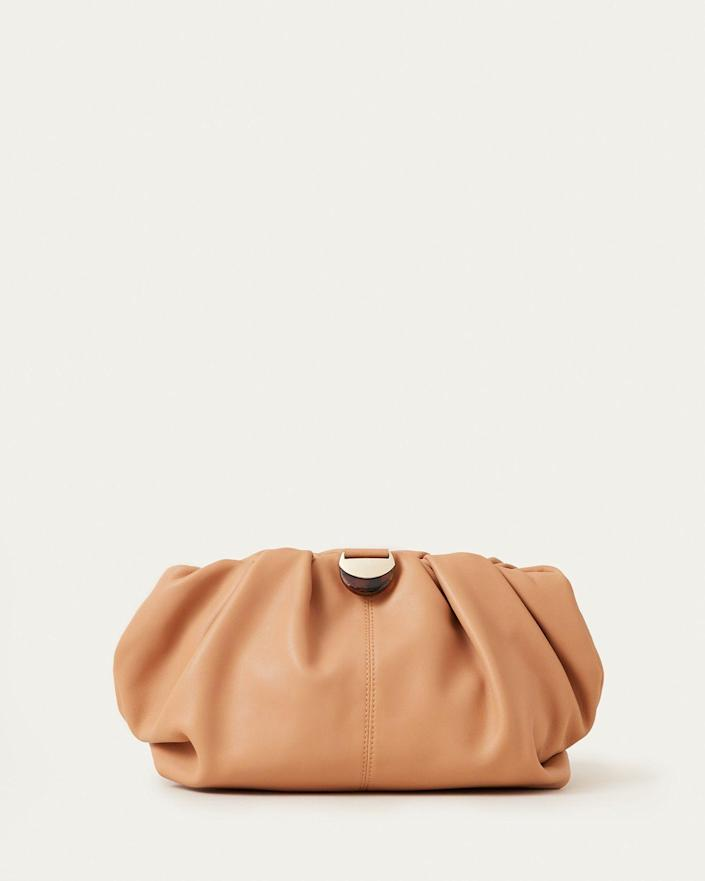 """<p><strong>Loeffler Randall</strong></p><p>loefflerrandall.com</p><p><strong>$295.00</strong></p><p><a href=""""https://go.redirectingat.com?id=74968X1596630&url=https%3A%2F%2Floefflerrandall.com%2Fproducts%2Fanaleigh&sref=https%3A%2F%2Fwww.marieclaire.com%2Ffashion%2Fg35621230%2Ffall-bag-trends-2021%2F"""" rel=""""nofollow noopener"""" target=""""_blank"""" data-ylk=""""slk:SHOP IT"""" class=""""link rapid-noclick-resp"""">SHOP IT</a></p><p>The tortoise-effect hardware on this clutch is the super chic detail that sets this particular style apart from the bunch.</p>"""