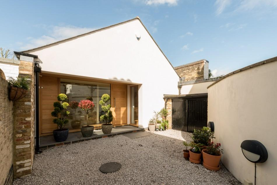<p>The new family home sits on the site of a former dairy and is hidden down a narrow gravel drive behind security gates in Kingston-upon-Thames. The property is spread over two floors and boasts three bedrooms, plus a music room which could double up as a guest bedroom. </p>