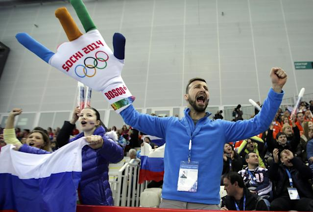 A fan cheers during the Men's 5000m speed skating event at the 2014 Winter Olympics, Saturday, Feb. 8, 2014, in Sochi, Russia. (AP Photo/David J. Phillip )