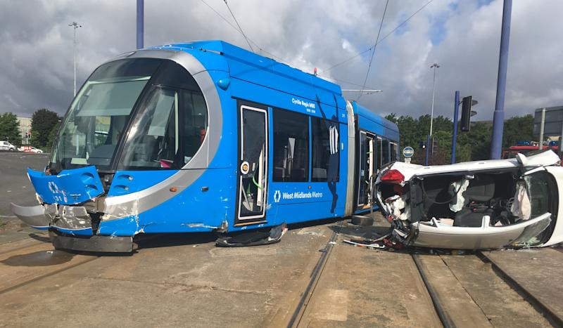 Five people were treated at the scene of a collision between a car and a tram this morning in Wolverhampton. (SWNS)