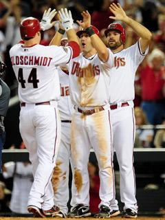Paul Goldschmidt rounded the bases after his grand slam and was met by Willie Bloomquist (center) and pitcher Josh Collmenter