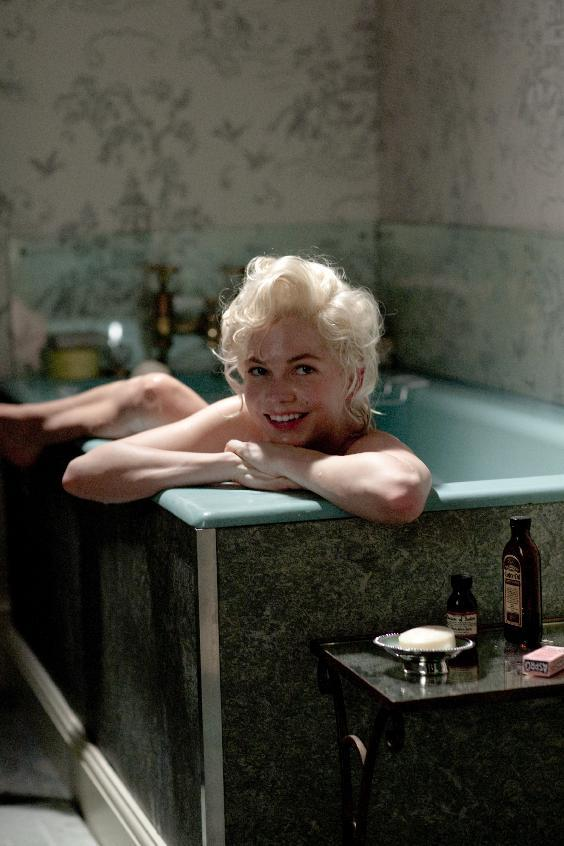 "In this film publicity image released by The Weinstein Company, Michelle Williams portrays Marilyn Monroe in a scene from ""My Week with Marilyn."" The film was nominated Thursday, Dec. 15, 2011 for a Golden Globe award for best comedy or musical film. The Golden Globes will be presented Jan. 15 at the Beverly Hilton Hotel, televised live by NBC and hosted by Ricky Gervais. (AP Photo/The Weinstein Company, Laurence Cendrowicz)"