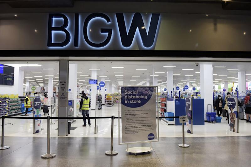 A social distancing sign stands at the entrance to a Big W store in Melbourne.