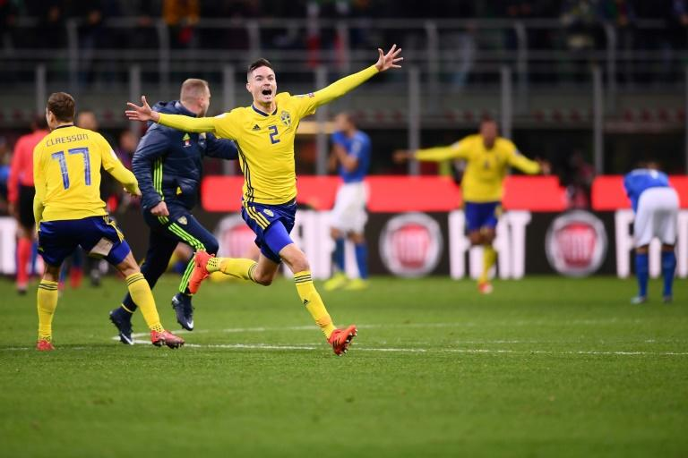 Sweden's Mikael Lustig celebrates at the end of the World Cup qualification match against Italy at the San Siro stadium in Milan