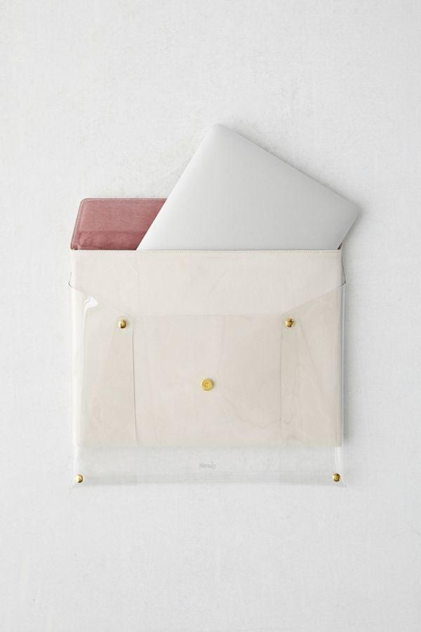 """<p><a href=""""https://www.popsugar.com/buy/Sonix-Transparent-Laptop-Clutch-Case-473621?p_name=Sonix%20Transparent%20Laptop%20Clutch%20Case&retailer=urbanoutfitters.com&pid=473621&price=40&evar1=geek%3Aus&evar9=46434052&evar98=https%3A%2F%2Fwww.popsugar.com%2Fnews%2Fphoto-gallery%2F46434052%2Fimage%2F46434053%2FSonix-Transparent-Laptop-Clutch-Case&list1=urban%20outfitters%2Claptop%20bags%2Ctech%20accessories&prop13=api&pdata=1"""" rel=""""nofollow"""" data-shoppable-link=""""1"""" target=""""_blank"""" class=""""ga-track"""" data-ga-category=""""Related"""" data-ga-label=""""http://www.urbanoutfitters.com/shop/sonix-transparent-laptop-clutch-case?category=new-music-tech&amp;color=014&amp;quantity=1&amp;size=ONE%20SIZE&amp;type=REGULAR"""" data-ga-action=""""In-Line Links"""">Sonix Transparent Laptop Clutch Case</a> ($40)</p>"""