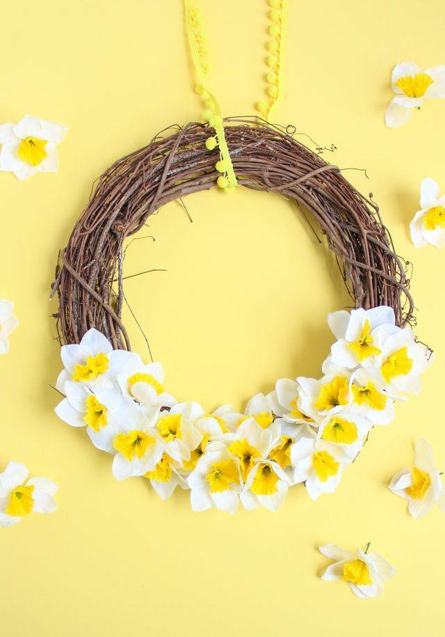 """<p>While the daffodils may be in full bloom outside, they can flourish indoors all season long with the help of some faux flowers.</p><p><strong>Get the tutorial at <a href=""""https://designimprovised.com/2018/04/5-minute-spring-daffodil-wreath.html"""" rel=""""nofollow noopener"""" target=""""_blank"""" data-ylk=""""slk:Design Improvised"""" class=""""link rapid-noclick-resp"""">Design Improvised</a>.</strong></p><p><a class=""""link rapid-noclick-resp"""" href=""""https://go.redirectingat.com?id=74968X1596630&url=https%3A%2F%2Fwww.walmart.com%2Fip%2FClauss-Titanium-Wire-Cutters%2F16560523&sref=https%3A%2F%2Fwww.thepioneerwoman.com%2Fhome-lifestyle%2Fcrafts-diy%2Fg35698457%2Fdiy-easter-wreath-ideas%2F"""" rel=""""nofollow noopener"""" target=""""_blank"""" data-ylk=""""slk:SHOP WIRE CUTTERS"""">SHOP WIRE CUTTERS</a></p>"""