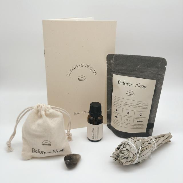 "<h2>Before Noon Grounding Tool Box</h2><br>Each box includes a crystal, a journal, a smudge stick, and <a href=""https://www.refinery29.com/en-us/essential-oils-for-stress"" rel=""nofollow noopener"" target=""_blank"" data-ylk=""slk:an essential oil"" class=""link rapid-noclick-resp"">an essential oil</a> — everything your friend needs to feel more centered and calm. <br><br><strong>Before Noon</strong> Grounding Tool Box, $, available at <a href=""https://go.skimresources.com/?id=30283X879131&url=https%3A%2F%2Fwww.beforenoon.co%2Fcollections%2Fall-products%2Fproducts%2Ftool-box-grounding"" rel=""nofollow noopener"" target=""_blank"" data-ylk=""slk:Before Noon"" class=""link rapid-noclick-resp"">Before Noon</a>"