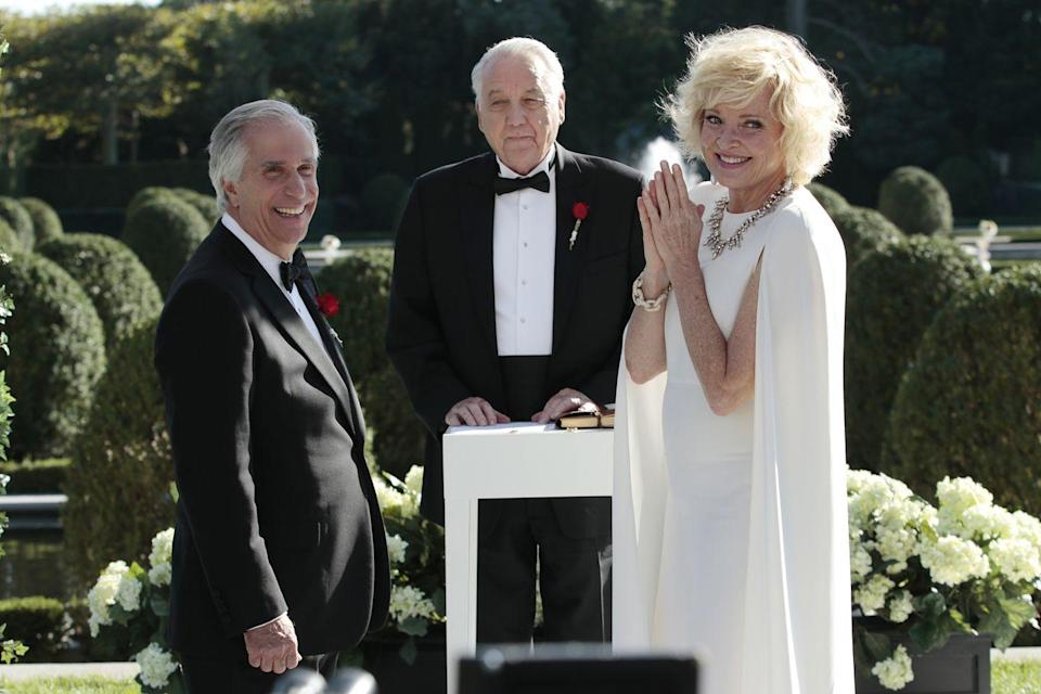 <p><em>Royal Pains </em>came full circle when Hank and Evans' father, Eddie, married their plastic surgery prone patient, Ms. Newberg. Even though the bride had been married at least three times before, she opted for a white cape dress. </p>