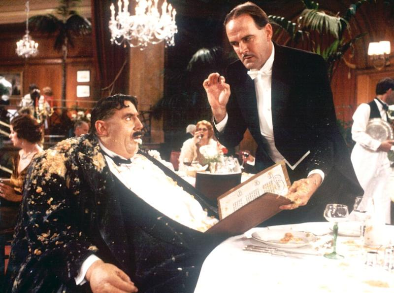 Terry Jones (L) and John Cleese inMonty Python's The Meaning of Life(1983) | Bielecki Movie Collection/Getty Images