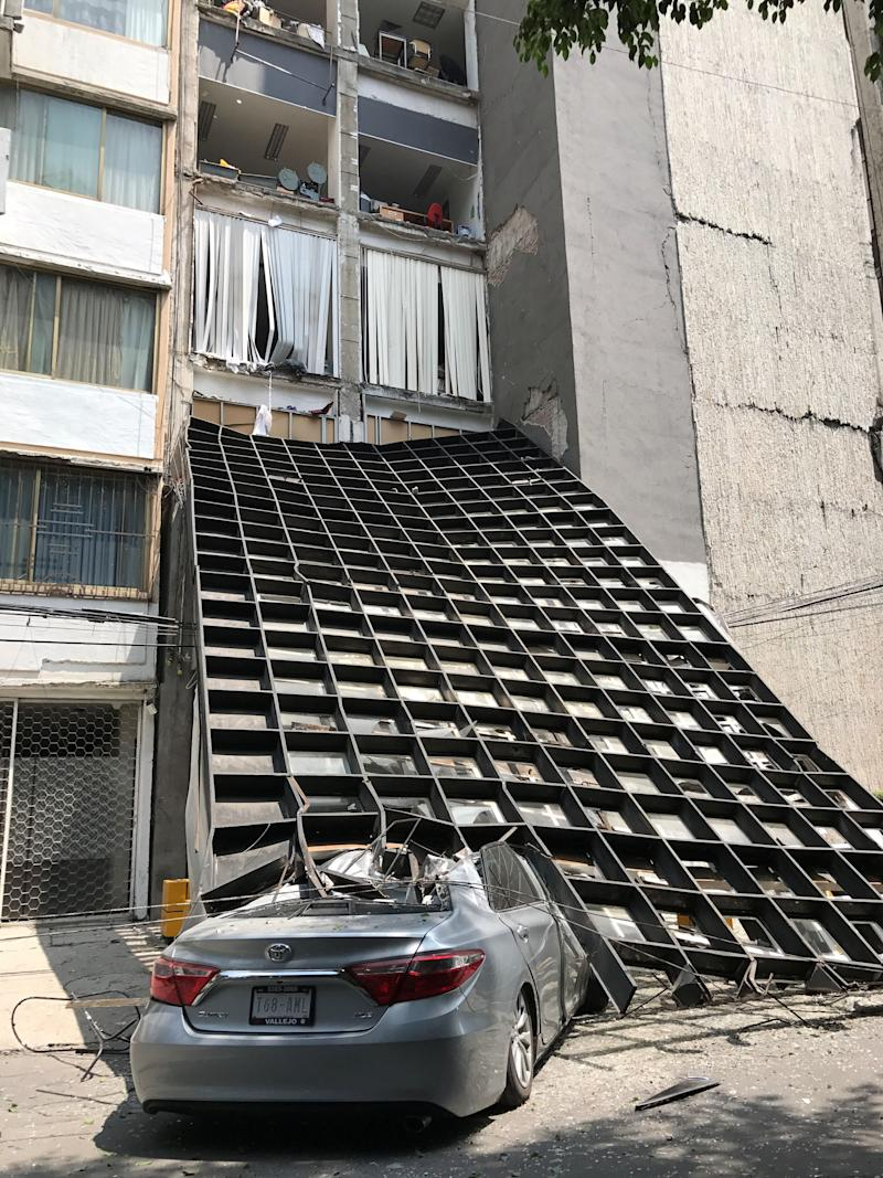 A building collapsed onto a car during the earthquake.