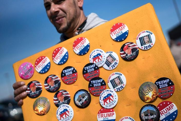 A vender sells campaign pins before a Donald Trump rally in Cleveland, Ohio (AFP Photo/Brendan Smialowski)