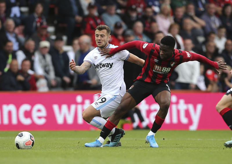 West Ham United's Jack Wilshere, left, and Bournemouth's Jefferson Lerma clash during their English Premier League soccer match at the Vitality Stadium in Bournemouth, England, Saturday, Sept. 28, 2019. (Mark Kerton/PA via AP)