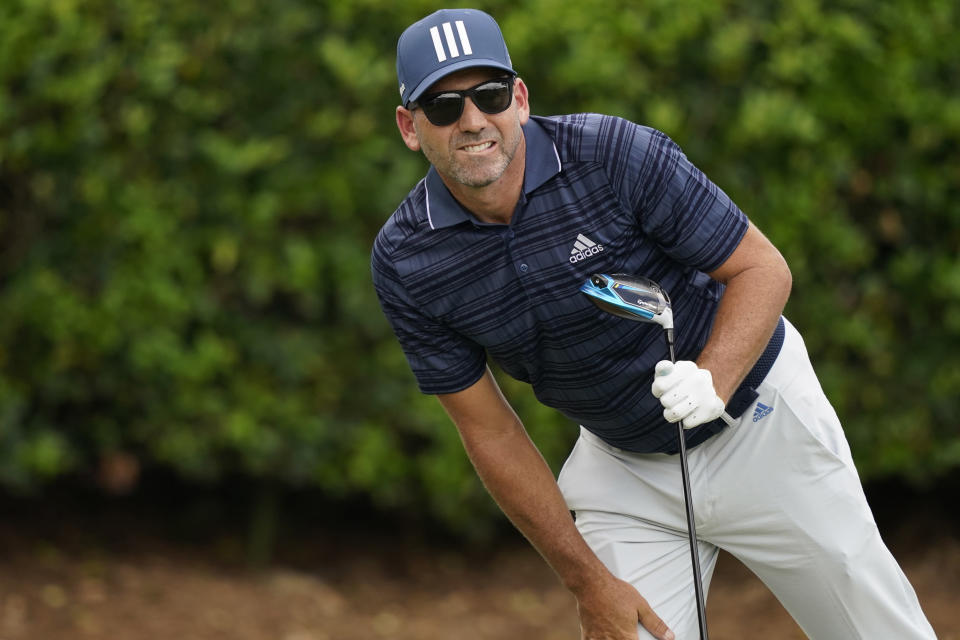 Defending champion Sergio Garcia, of Spain, leans over to watch his drive on the first hole during the first round of the Sanderson Farms Championship golf tournament in Jackson, Miss., Thursday, Sept. 30, 2021. (AP Photo/Rogelio V. Solis)