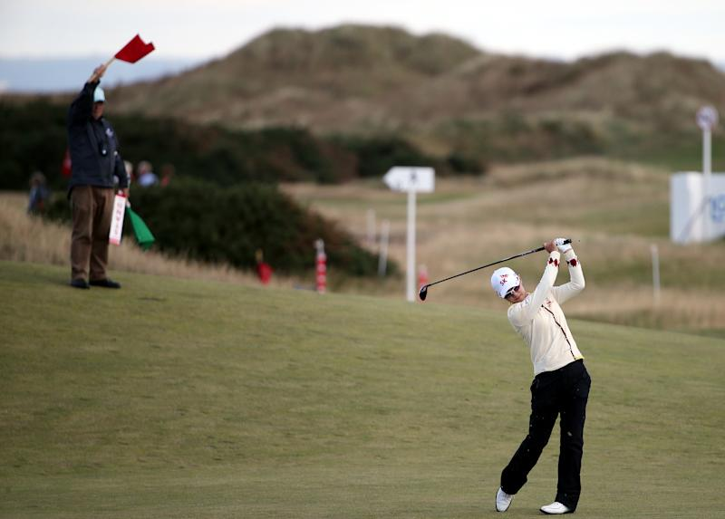Korea's Na Yeon Choi plays a shot from the 15th fairway during the third round of the Women's British Open golf championship on the Old Course at St Andrews, Scotland, Sunday Aug. 4, 2013. (AP Photo/Scott Heppell)