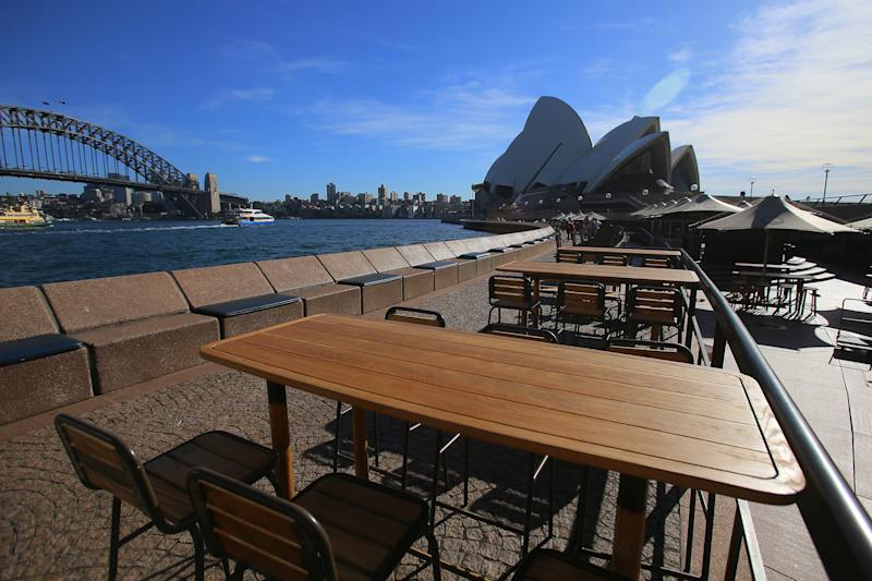 Empty tables at Sydney's famous Opera Bar as the state prepared to enforce a comprehensive shutdown. Source: Getty Images