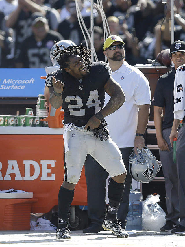 "<a class=""link rapid-noclick-resp"" href=""/nfl/players/8266/"" data-ylk=""slk:Marshawn Lynch"">Marshawn Lynch</a> is having some fun in Oakland. (AP Photo/Ben Margot)"