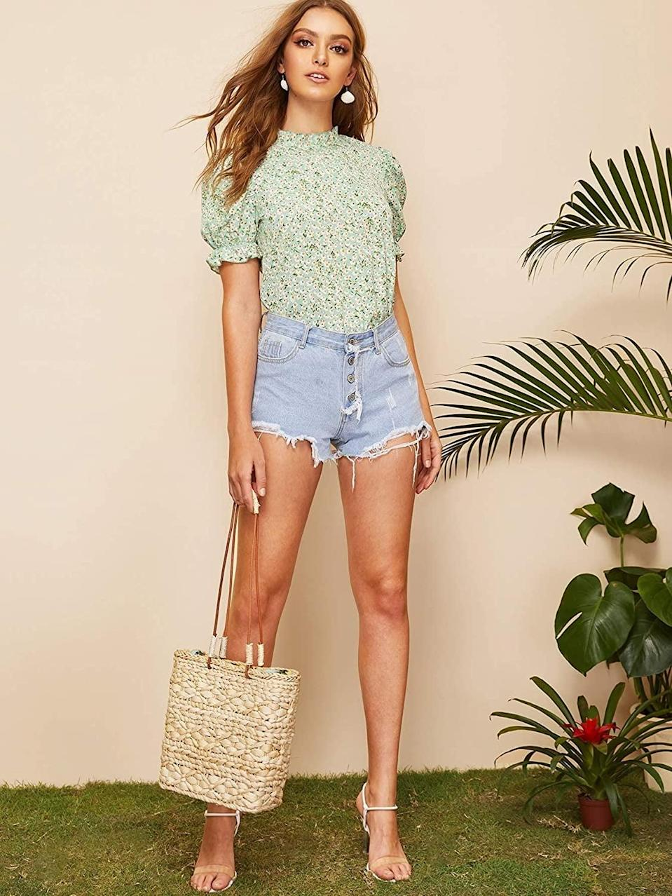 <p>Take this <span>Romwe Floral Print Top</span> ($18) on your next warm vacation.</p>