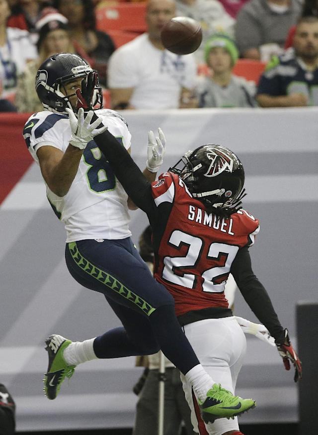 Seattle Seahawks wide receiver Golden Tate (81) waits for a ball as Atlanta Falcons cornerback Asante Samuel (22) defends during the first half of an NFL football game, Sunday, Nov. 10, 2013, in Atlanta. The play was ruled incomplete. (AP Photo/John Bazemore)