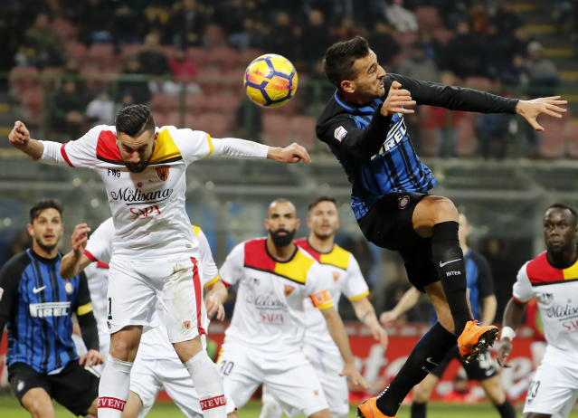 Inter Milan's Matias Vecino, right, jumps for the ball with Benevento's Massimo Coda during the Serie A soccer match between Inter Milan and Benevento at the San Siro stadium in Milan, Italy, Saturday, Feb. 24, 2018. (AP Photo/Antonio Calanni)