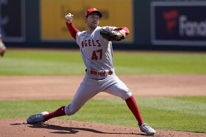 Los Angeles Angels starting pitcher Griffin Canning delivers to a Kansas City Royals batter.