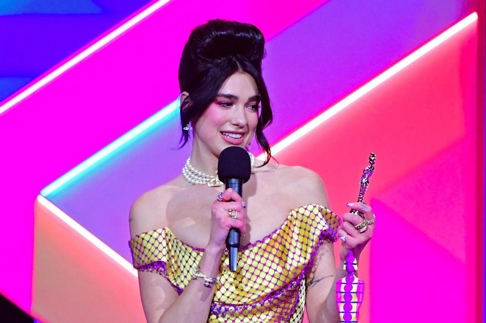 Dua Lipa accepts the award for Female Solo Artist during the Brit Awards 2021  (PA)